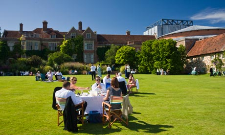 Festival goers picnic in the grounds of Glyndebourne Opera House